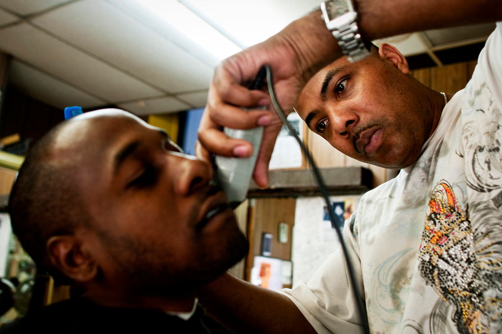 Barber Garfield Myrie gives a customer a cut.