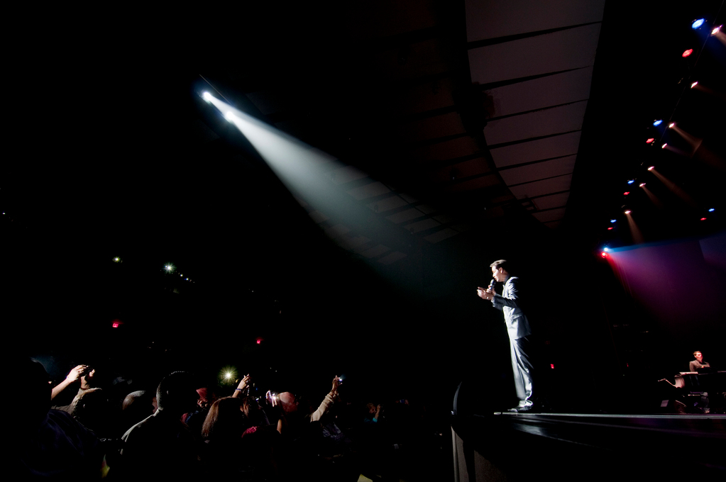 September 18, 2010 - Bronx, NY : Lehman Center kicked off its 30th anniversary season with a concert featuring salsa legend Victor Manuelle on Satuday night. Fans snap photos of Manuelle as he addresses the audience from the edge of the stage.