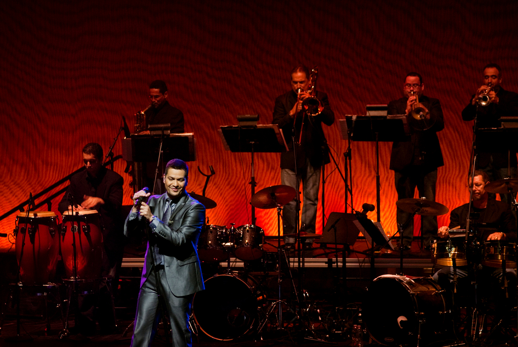 Victor Manuelle takes the stage with his band.