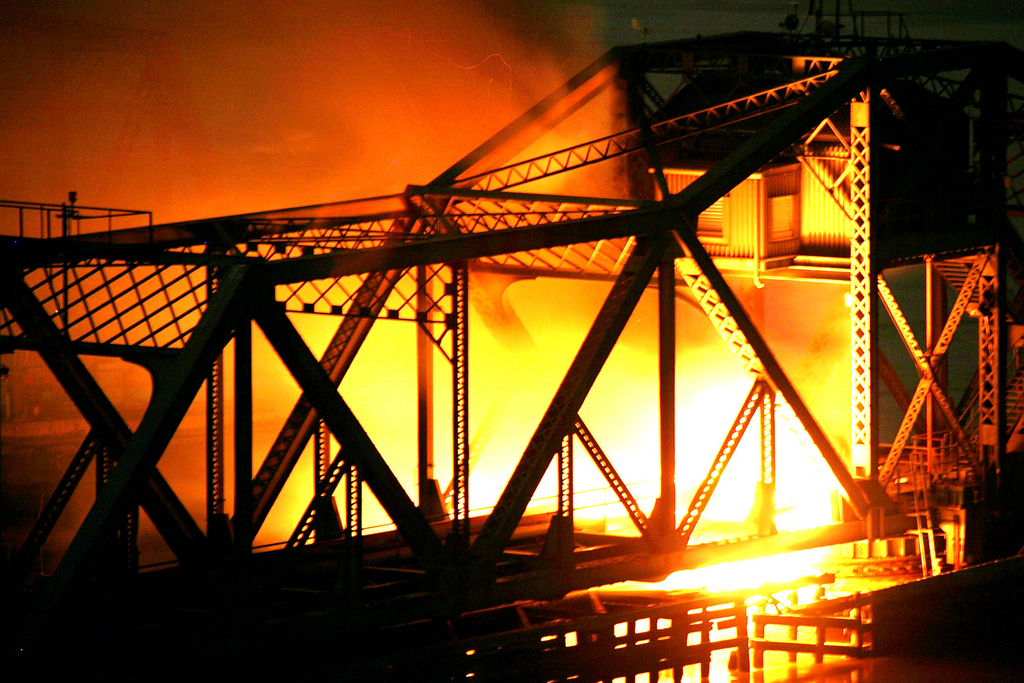 A blaze engulfs the Spuyten Duyvil railroad bridge at approximately 2:30 a.m. on Oct. 24.