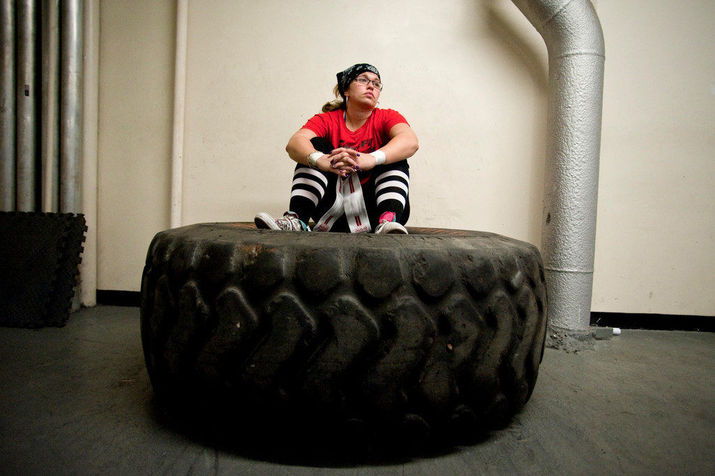 Alexandra Dante sits in a giant tire as she awaits the start of the final contest--a 445 lb weight pull.
