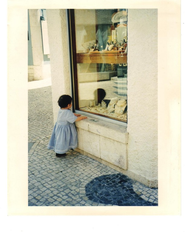 Little Girl and jewelry store window, Cascais, Portugal