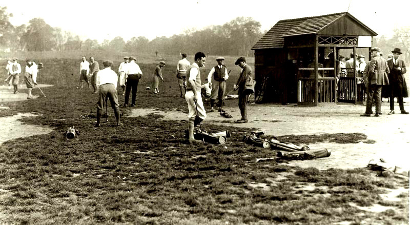 A historic photo shows golfers wielding their clubs on a course that is rustic at best.