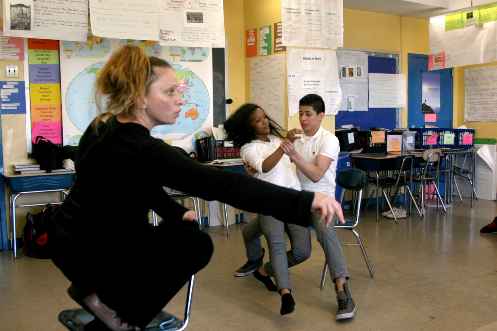 Ballroom dance instructor, Ms. Evangelina, guides her students at E.L.L.I.S. as part of the Bronx Arts Ensemble's program.