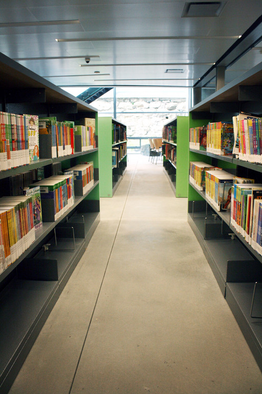 The new Kingsbridge Public Library features thousands of volumes of books for visitors to enjoy.