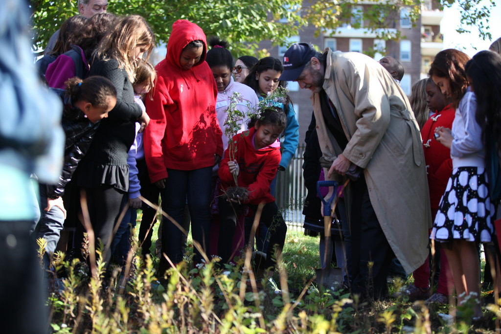 P.S. 24 assists David Burg, right, to honor his daughter Abigail during the Abigail Burg garden memorial dedication ceremony on Friday, October 28, 2011.