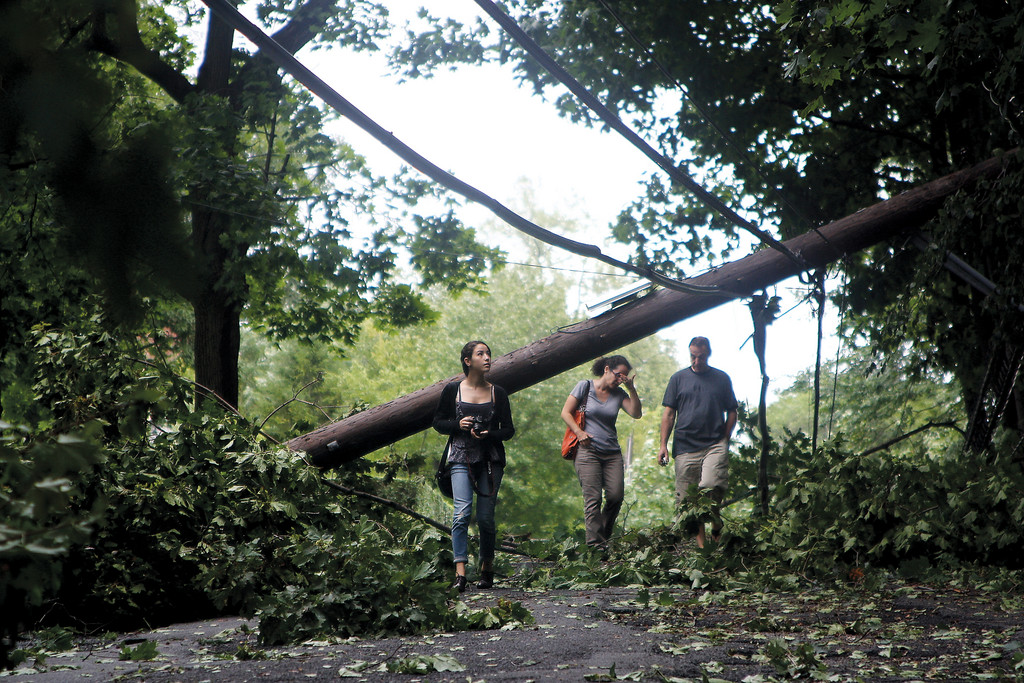 A group makes their way down West 231st Street near Palisade Avenue on Aug. 28, in the aftermath