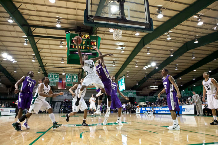 Manhattan College's George Beamon leaps toward the basket but is fouled by Niagara. MC still went on to win 71-64.