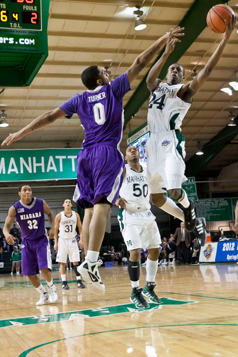 George Beamon, a junior at Manhattan College, right, keeps control of the ball during Sunday's game against Niagara at Draddy Gymnasium. The Jaspers won 71-64.