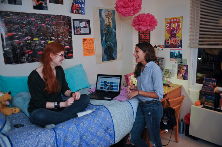 Manhattan College students participating in The Arches, a program to orient incoming freshman,laugh in a dorm room.