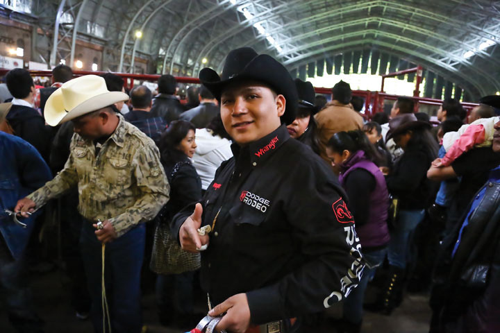 José Luis Milza poses for a picture in full rodeo attire.