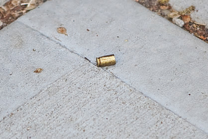 A bullet casing that was found on Friday morning, about 40 feet from the spot were Hwang Yang was killed. The bullet was fired from a .380 caliber pistol cartridge, police said.