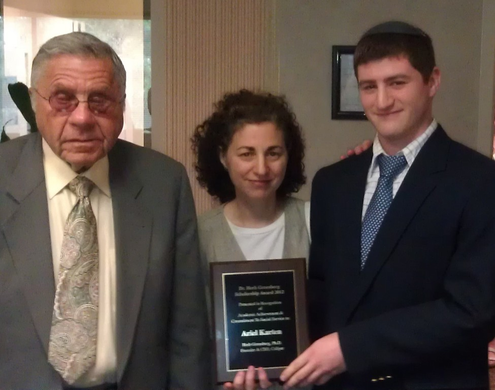 Ariel Karten of Riverdale standing next his mother was presented with the scholarship award at Caliper%u2019s corporate headquarters in Princeton, NJ on Wednesday, May 30th by Herb Greenberg, founder and CEO of Caliper Corporation.