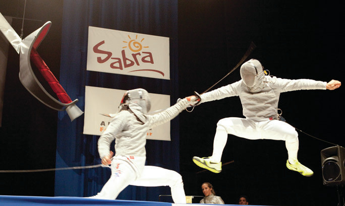 Riverdalian and Olympian Tim Morehouse, right, attacks James Williams in a fencing match at Hammerstein Ballroom in Manhattan on June 26.