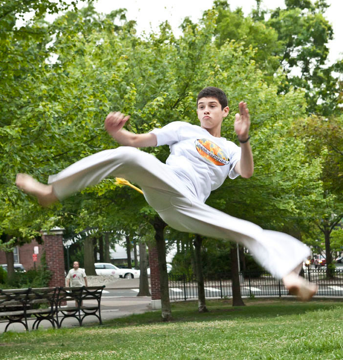 Brandon Taft does an Armada com martelo kick on July 13 during the free Friday Capoeira classes at Van Cortlandt Park.
