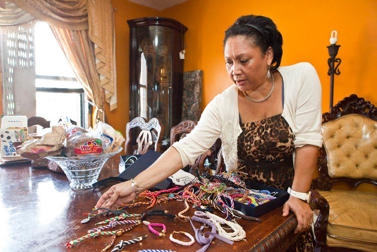 Artist Mercedes Polanco shows off her handmade bracelets in her Bailey Avenue apartment on Monday.