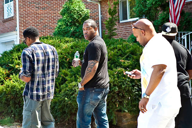 Mourners, including Busta Rhymes, center, gather outside of Chris Lighty's home on the day of his death.