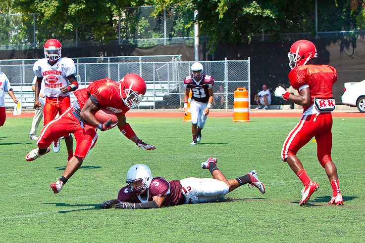 Senior Running Back Matthew Evora makes a first down for JFK in Staten Island on Saturday.