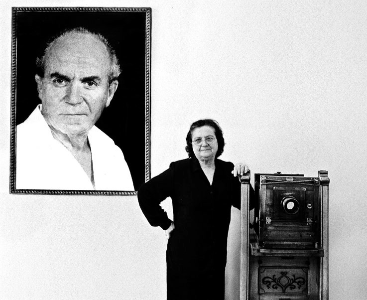 'There are no foreigners in Albania, only guest.' — Drita Vesli with a portrait of her late husband, Refik Vaseli.