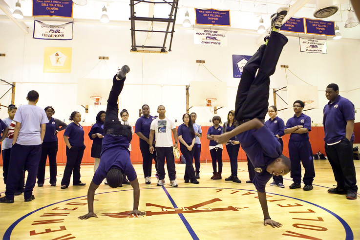 Jubori Chaplin and Floyd Bobb, ninth graders at New Visions Charter High School for Humanities, practice handstands at a Capoeira class on Sept. 14.