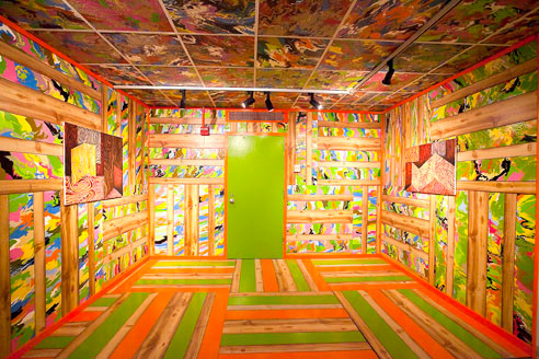 Robert Melle's installation 'High Life,' is made of enamel on imitation wood panels, drop ceiling panels and fiberglass.