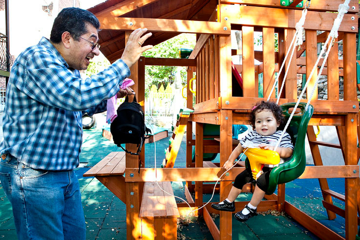 Victoria Cardinale, 3, laughs as her grandpa Angel Quinteros pushes her on a swing at Kouli Nalpantidis' sensory gym on Oct. 5.