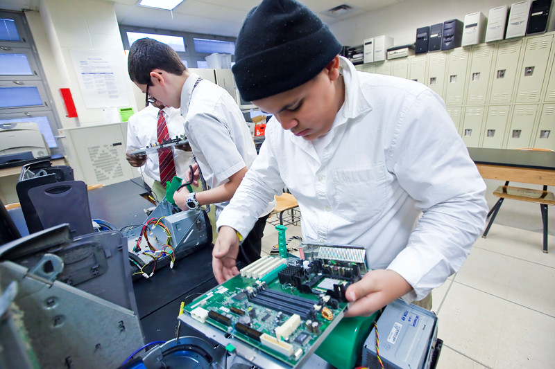Bryan Liriano, 13, learns the components of a computer by taking one apart and putting it back together at IN-Tech Academy, MS/HS 368 on Nov. 8.