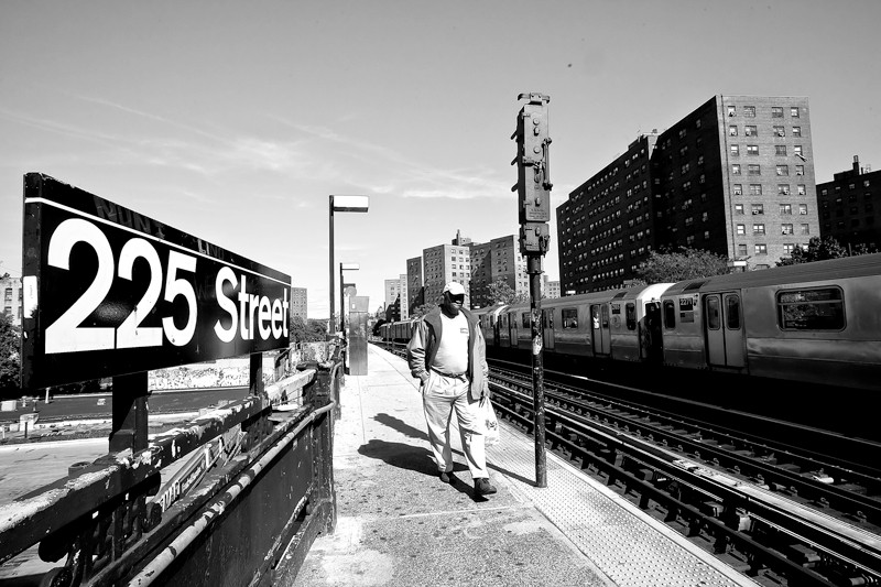 Derrick Dixon walks along the No. 1 train platform on his way home to the Promenade building on Oct. 1.