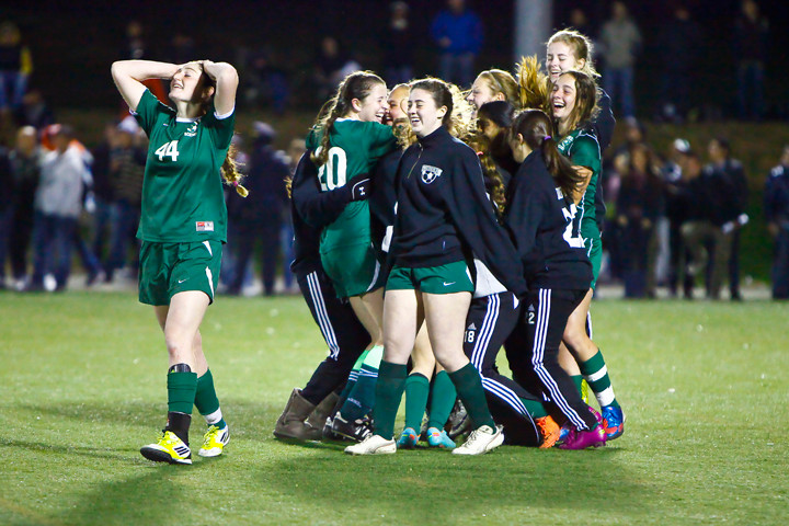 Alexandra Scheman holds her head as her Bronx Science teammates celebrate winning the 2012 PSAL soccer championships at Randall�s Island on Nov. 18.