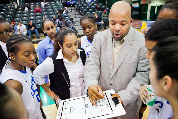 Lehman College Lightning coach Eric Harrison talks strategy with his team.