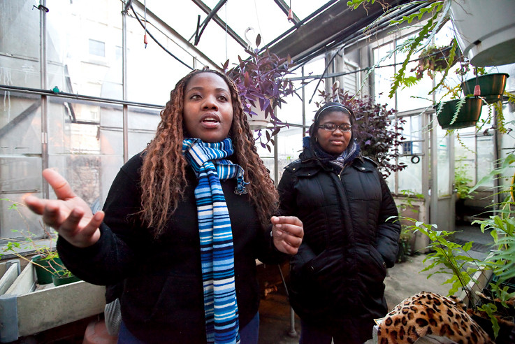 Shanice Smellie, left, and Amanda Simon, both DeWitt Clinton High School seniors, discuss their scientific research at Lehman College on Dec. 19.