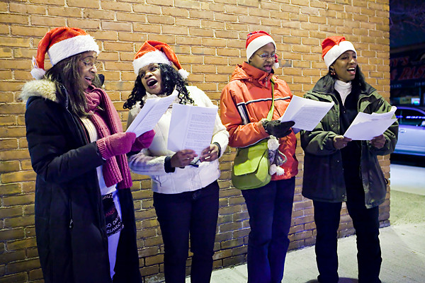 Pamela Bodley, Pat Hall, Hope Gupple and Tina Davy sing Christmas carols on Johnson Avenue and West 235th Street on Dec. 20.