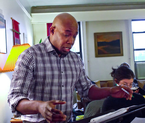 Eric McKeever sings at a recitative rehearsal in Artist Director Michael Spierman's apartment on Nov. 10 for the upcoming performance of 'La Gazza Ladra.'