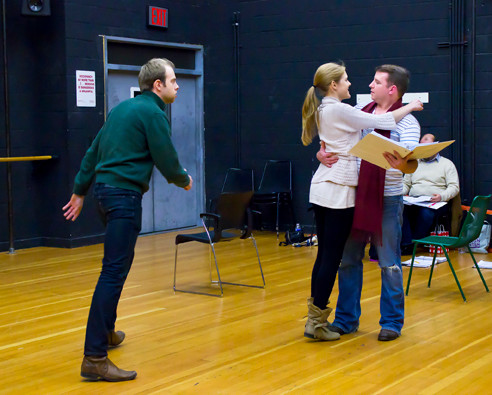 Erik Bagger 'Antonio' urges John Calkins 'Giannetto' who is in the midst of and embraces with Jennifer Moore 'Ninetta' to leave before they all get in trouble during a rehearsal of a scene from the opera 'La Gazza Ladra' at Lehman College on Dec. 12.