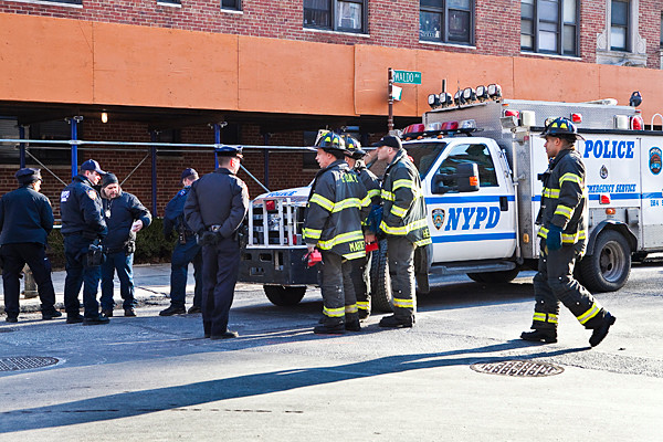 Police, firefighters and members of the NYPD bomb squad remove an explosive device from a heating duct in a common area of the Majestic, on Waldo Avenue, on Jan. 4.