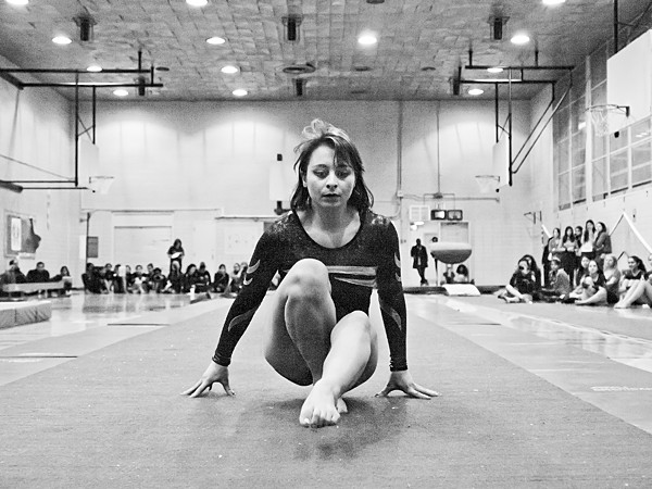 Martina Cox, a 17-year-old Bronx High School of Science student, begins her floor exercise routine in a competition against DeWitt Clinton on Jan. 4.