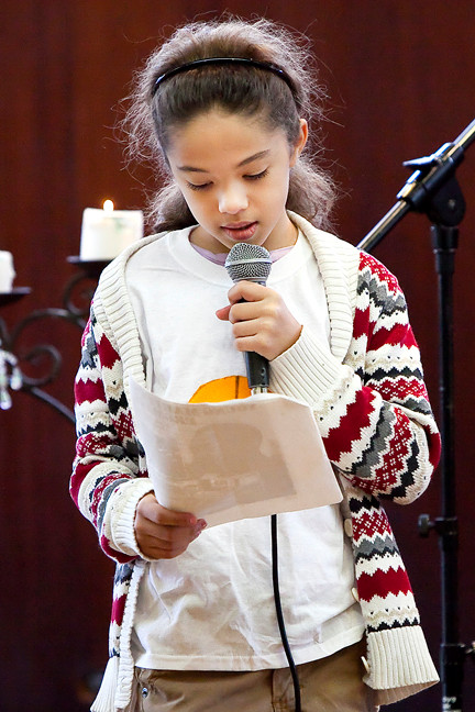 Kamila Piña, 10, speaks about the Martin Luther King holiday during a presentation at the Riverdale-Yonkers Society for Ethical Culture Sunday.