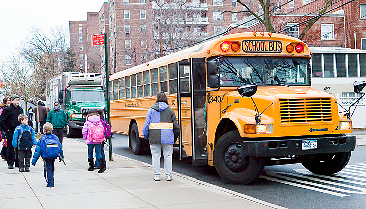 School Children get dropped off at Robert J. Christen, PS 81 on Tuesday, a day before drivers are scheduled to strike.