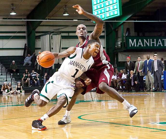 CJ Jones pushes past Anthony Myles at Draddy Gymnasium on Jan. 10. The Jaspers lost at home to Rider, 69-60.