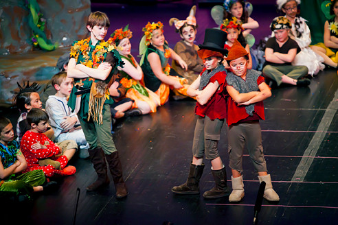 Noah Parnes, Dafna Horowitz and Naveah Diaz, standing from left to right, perform in the Riverdale Children's Theatre presentation of 'Peter Pan' at Lehman College's Lovinger Theatre Saturday night.