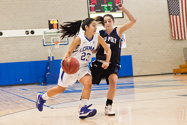 Jennifer Navarro works her way around NYU-Poly's Alyssa D'Apice on Monday. Lehman lost 67-56.