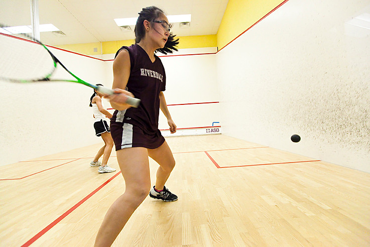 Monique Reichenstein, a junior on Riverdale Country School's squash team, makes a return against Kelly Saxton from Hackley School at the Pyramid Squash Club on Jan. 18.