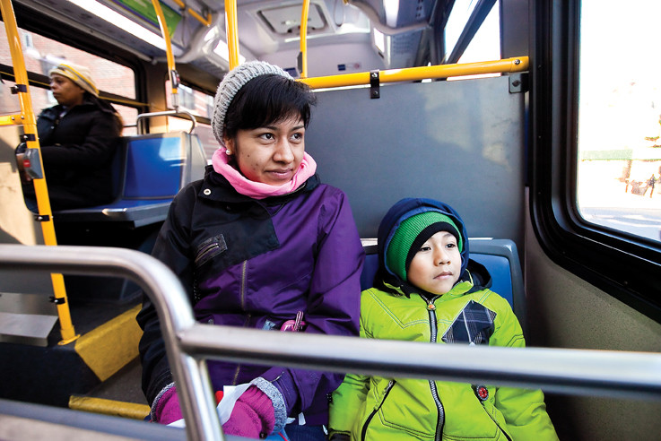 Marilu Ocampo and her son Martin Lopez, 5, bear sub-20 degree weather while riding the city bus from Kingsbridge to AmPark Neighborhood School Tuesday. Ms. Ocampo said despite the inconvenience of waiting for the bus, she supports the school bus drivers and matrons on strike.