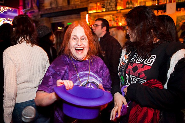 Ilene Richards does her part to help raise money by passing the purple hat around the pub.