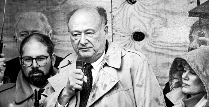 Mayor Ed Koch speaks at a rally to defend 'The Riverdale Press' after the paper's offices were firebombed in 1989. At his left is Richard Stein, publisher of 'The Press.' At his right is then-Councilwoman June Eisland. Mr. Koch was among two mayoral candidates to attend the gathering.