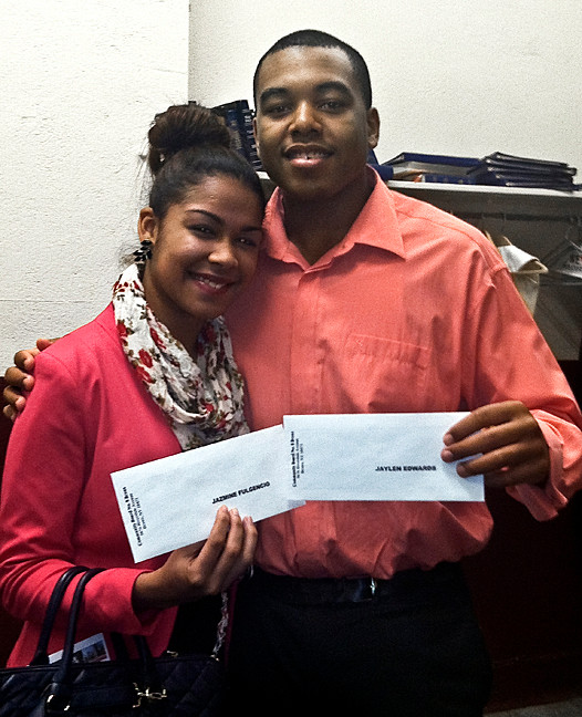 Jazmine Fulgencio, 18, and Jaylen Edwards, 17, hold up their New York Yankees Youth Leadership Awards at the Riverdale Presbyterian Church on Feb. 12. They were selected for their volunteer work at Kingsbridge Heights Community Center.