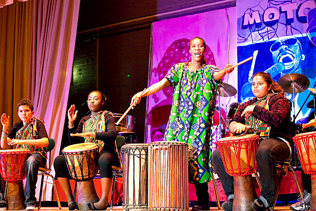 Gohoun Yobo, an African dance and drum teacher, leads Angel Lara Dixon, Fiona Sampany and Bryanna Marion, left to right, during 'NSLA's Journey to Motown' show.