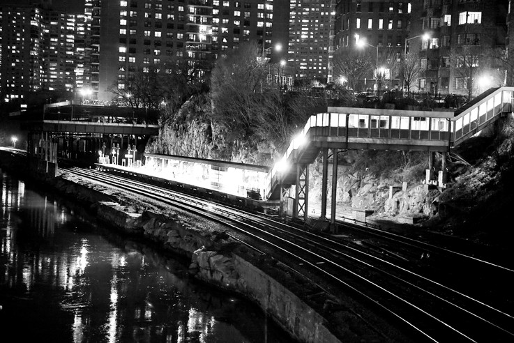 The Spuyten Duyvil Metro-North Station gives off an unearthly glow accentuated by Ms. Díaz's monochromatic photography.