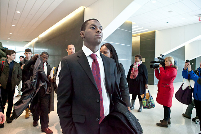 Boubacar Diallo, 16, approaches the entrance of the courtroom.