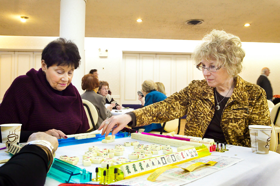 Carole Feinerg and Dorothy Feldman participate in a game of Mah Jongg on Sunday during the Riverdale Temple Women of Reform Judaism's annual card party at the Riverdale Temple.